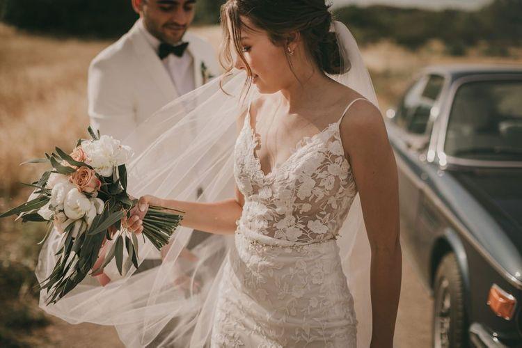 Lace detail Emmy Mae wedding dress with blush bouquet