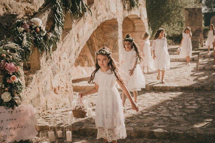 Flower girls with flower crowns at destination wedding