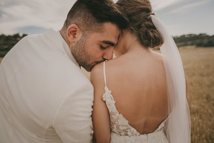 Bride and groom at destination wedding with white tuxedo jacket
