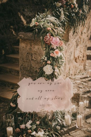 Pink wedding flowers with wedding signs