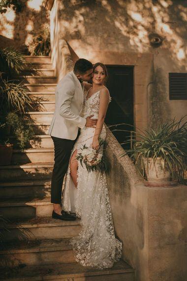 Groom in white tuxedo jacket for destination wedding