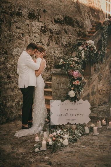 Bride and groom at destination wedding with pink wedding flowers