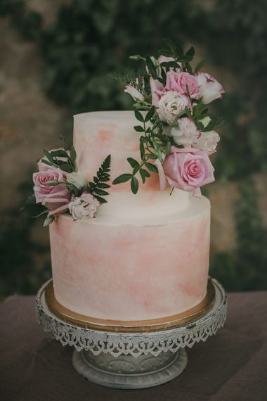 Ombre wedding cake with pink flower detail