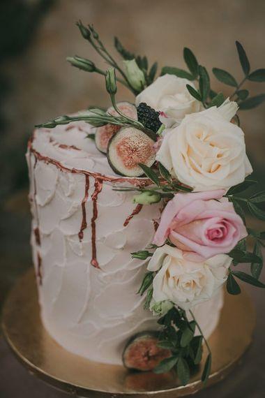 Beautiful rustic wedding cake with flower decor