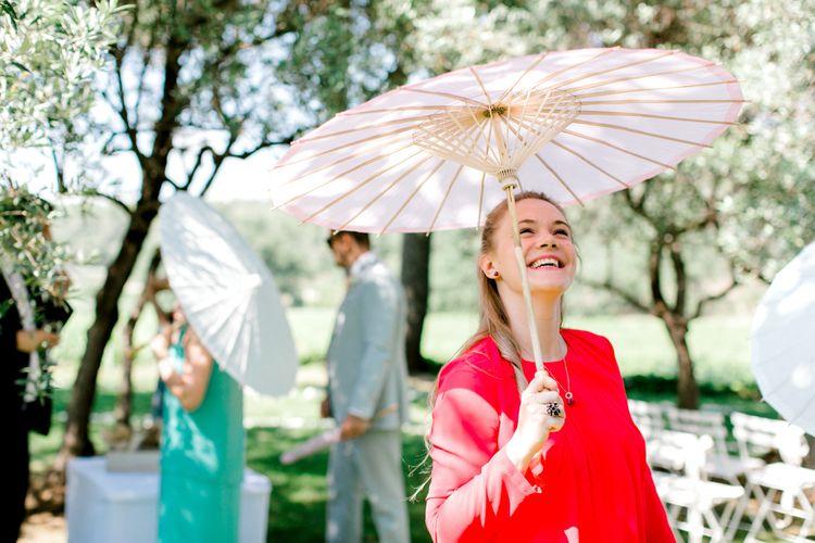 Wedding Guest Under Paper Parasol