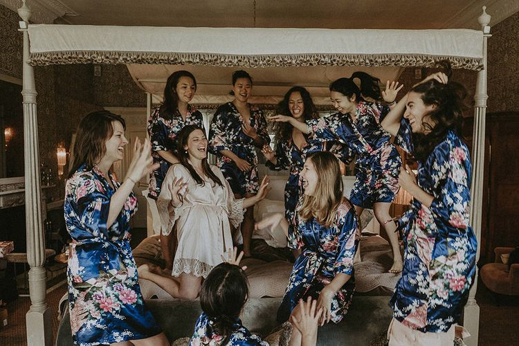 Wedding Morning Bridal Party Preparations with Bridesmaids in Floral Getting Ready Robes