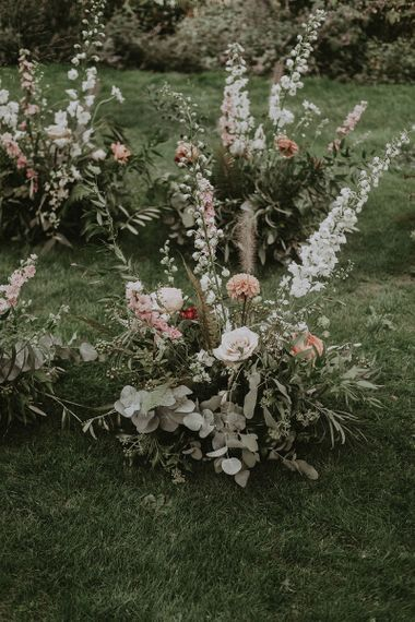 Outdoor Ceremony Floral Decor with Eucalyptus, Roses and Foxglove