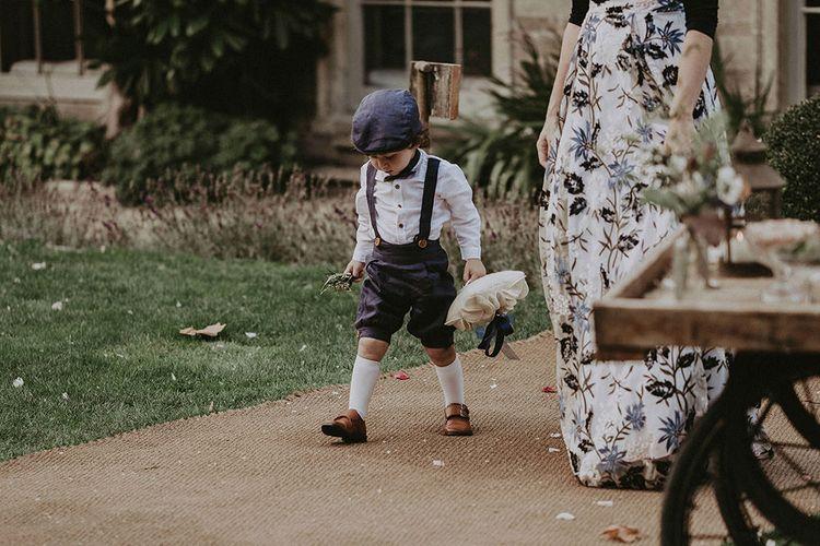 Page Boy Walking Down Aisle