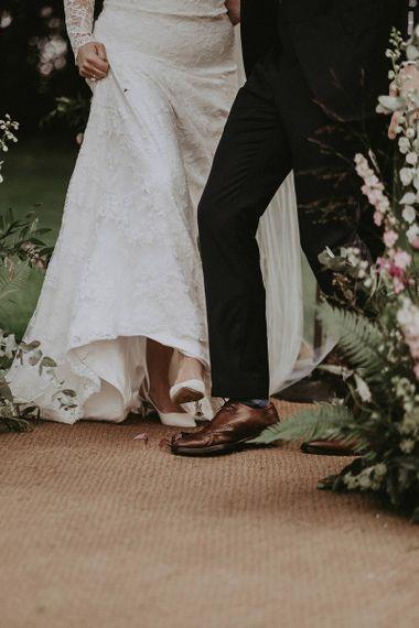Bride Wearing White Jimmy Choo Shoes