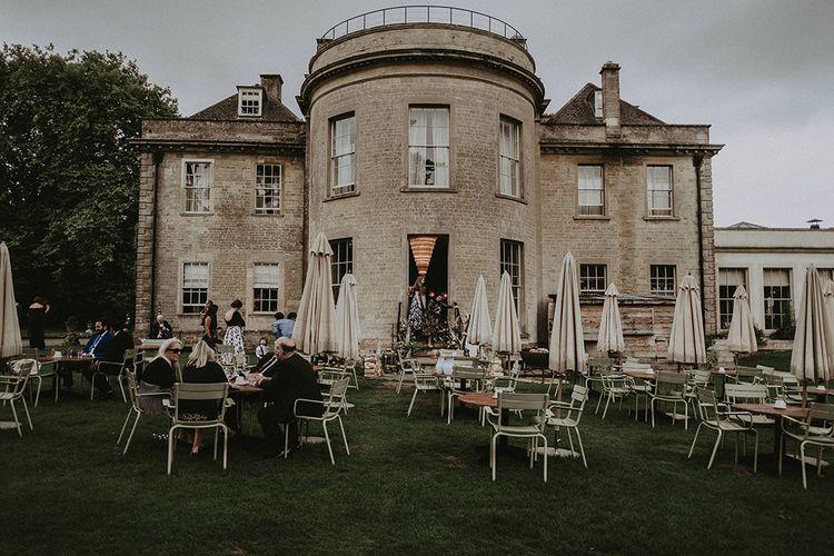 Wedding Guests Enjoying Reception Outdoors at Babington House