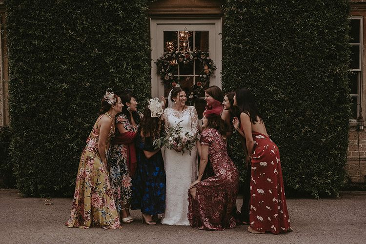 Bride with Bridesmaids in Mismatched Floral Dresses and Fascinators