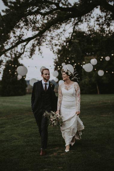 Bride and Groom Walking Through Gardens at Babington House
