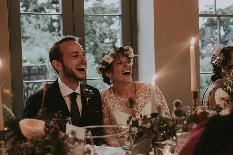 Bride and Groom Laughing During Wedding Breakfast
