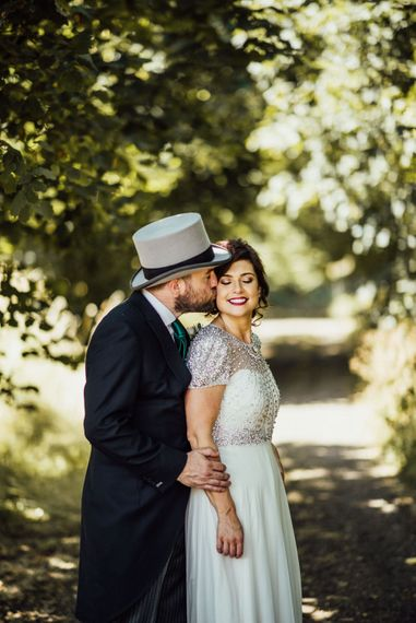 Groom In Top Hat And Bride In Jenny Packham Wedding Dress