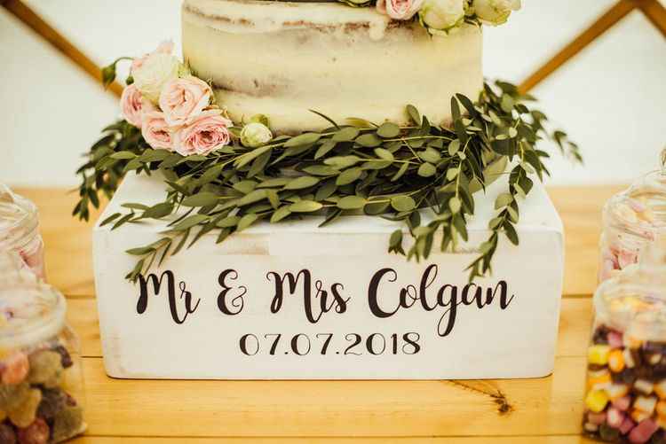 Semi Naked Wedding Cake With Fresh Flowers // Yurt Wedding With Outdoor Humanist Ceremony Bride In Jenny Packham And Groom In Top Hat With Images From Michelle Wood Photographer