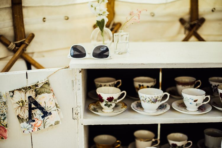 Vintage Tea Cups In Dresser For Wedding Guests // Yurt Wedding With Outdoor Humanist Ceremony Bride In Jenny Packham And Groom In Top Hat With Images From Michelle Wood Photographer