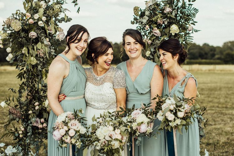 Classic Wedding Party In Sage Green // Floral Arch For Wedding // Yurt Wedding With Outdoor Humanist Ceremony Bride In Jenny Packham And Groom In Top Hat With Images From Michelle Wood Photographer