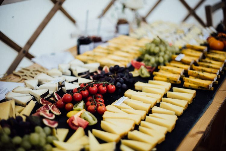 Cheese Table For Wedding Guests // Yurt Wedding With Outdoor Humanist Ceremony Bride In Jenny Packham And Groom In Top Hat With Images From Michelle Wood Photographer