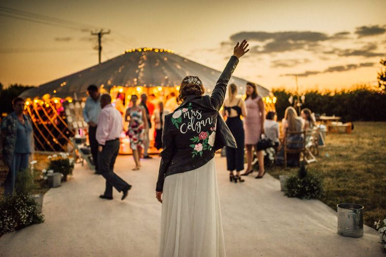 Bride In Personalised Leather Jacket // Yurt Wedding With Outdoor Humanist Ceremony Bride In Jenny Packham And Groom In Top Hat With Images From Michelle Wood Photographer