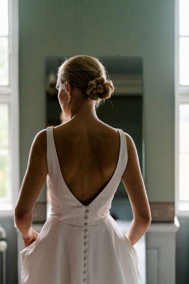 Elegant Bride in Caroline Castigliano Wedding Dress with Buttons on the Back | Traditional Green/Blue Danish Wedding at Scandinavian Country House, Jomfruens Egede in Faxe, Denmark | John Barwood Photography