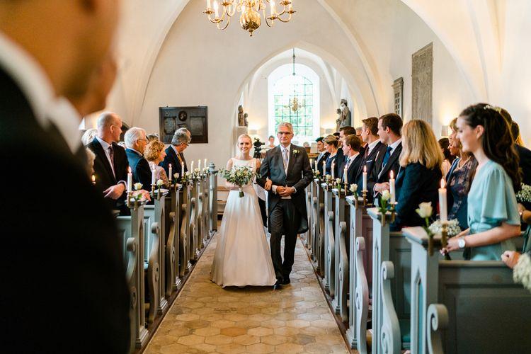 Church Wedding Ceremony | Bridal Entrance  in Caroline Castigliano Wedding Dress | Traditional Green/Blue Danish Wedding at Scandinavian Country House, Jomfruens Egede in Faxe, Denmark | John Barwood Photography