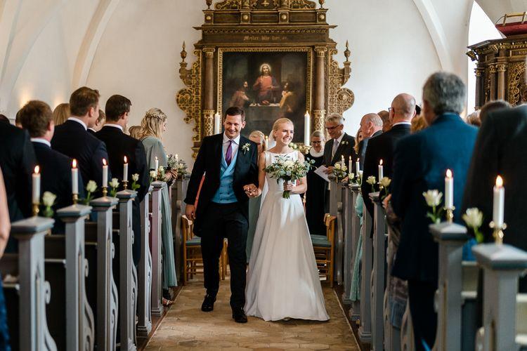 Wedding Ceremony | Bride in Caroline Castigliano Wedding Dress | Groom in Henry Herbert Tailors Morning Suit | Traditional Green/Blue Danish Wedding at Scandinavian Country House, Jomfruens Egede in Faxe, Denmark | John Barwood Photography