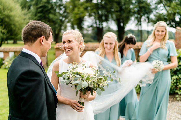 Bride in Caroline Castigliano Wedding Dress | Groom in Henry Herbert Tailors Morning Suit | Traditional Green/Blue Danish Wedding at Scandinavian Country House, Jomfruens Egede in Faxe, Denmark | John Barwood Photography