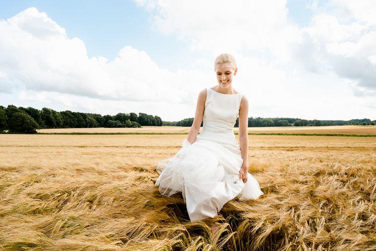Bride in Caroline Castigliano Wedding Dress | Traditional Green/Blue Danish Wedding at Scandinavian Country House, Jomfruens Egede in Faxe, Denmark | John Barwood Photography