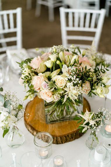 Pink, White & Green Floral Centrepiece on Tree Slab | Traditional Green/Blue Danish Wedding at Scandinavian Country House, Jomfruens Egede in Faxe, Denmark | John Barwood Photography