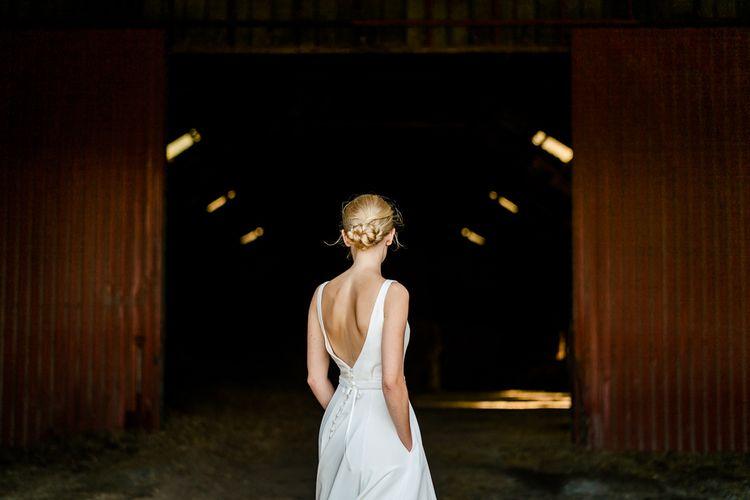 Bride in Caroline Castigliano Wedding Dress with Buttons on the Back | Traditional Green/Blue Danish Wedding at Scandinavian Country House, Jomfruens Egede in Faxe, Denmark | John Barwood Photography