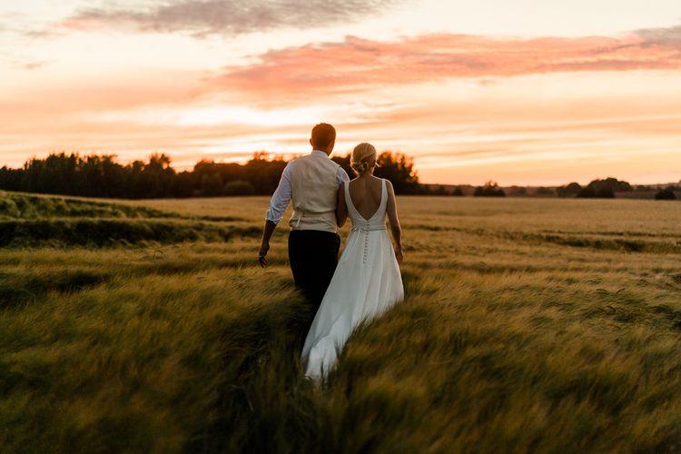 Sunset Portrait | Bride in Caroline Castigliano Wedding Dress | Groom in Henry Herbert Tailors Morning Suit | Traditional Green/Blue Danish Wedding at Scandinavian Country House, Jomfruens Egede in Faxe, Denmark | John Barwood Photography