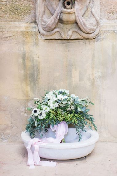 Anemone Wedding Bouquet with Pink Ribbon | Four Day Italian Destination Wedding at Frattoria Mansi Bernadini Planned by Weddings by Emily Charlotte | Cecelina Photography