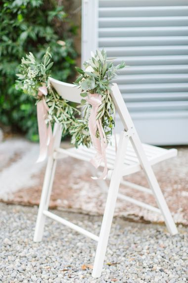 Greenery Garland Chair Back Decor with Pink Ribbon | Four Day Italian Destination Wedding at Frattoria Mansi Bernadini Planned by Weddings by Emily Charlotte | Cecelina Photography
