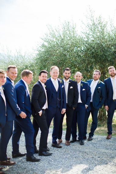 Groomsmen in Navy Suits | Four Day Italian Destination Wedding at Frattoria Mansi Bernadini Planned by Weddings by Emily Charlotte | Cecelina Photography