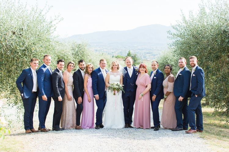Wedding Party | Bride in Lace Stella York Gown | Bridesmaids in Different Pink Dresses | Groomsmen in Navy Suits | Four Day Italian Destination Wedding at Frattoria Mansi Bernadini Planned by Weddings by Emily Charlotte | Cecelina Photography