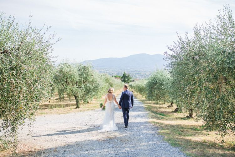 Bride in Lace Stella York Bridal Gown | Groom in Navy Suit | Four Day Italian Destination Wedding at Frattoria Mansi Bernadini Planned by Weddings by Emily Charlotte | Cecelina Photography