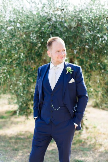 Groom in Three Piece Navy Suit & White Tie | Four Day Italian Destination Wedding at Frattoria Mansi Bernadini Planned by Weddings by Emily Charlotte | Cecelina Photography