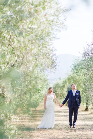 Bride in Lace Stella York Wedding Dress | Groom in Three Piece Navy Suit | Four Day Italian Destination Wedding at Frattoria Mansi Bernadini Planned by Weddings by Emily Charlotte | Cecelina Photography