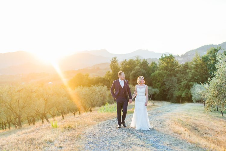 Sunset Portrait | Bride in Lace Stella York Wedding Dress | Groom in Three Piece Navy Suit | Four Day Italian Destination Wedding at Frattoria Mansi Bernadini Planned by Weddings by Emily Charlotte | Cecelina Photography