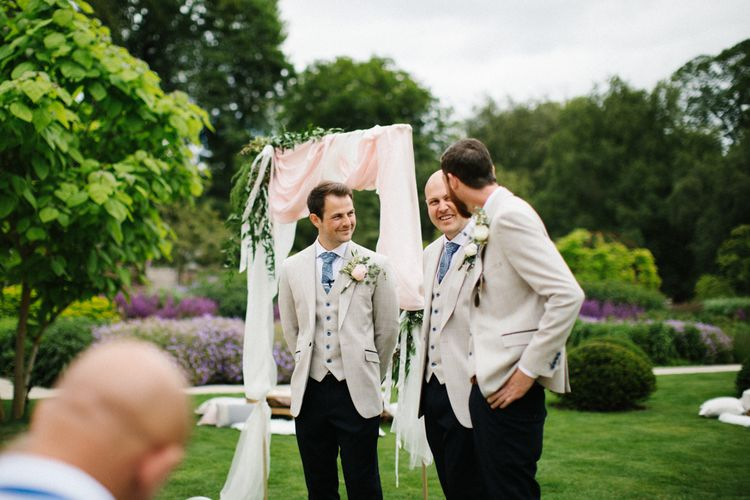 Groomsmen at the Altar in Beige Blazers and Black Chinos