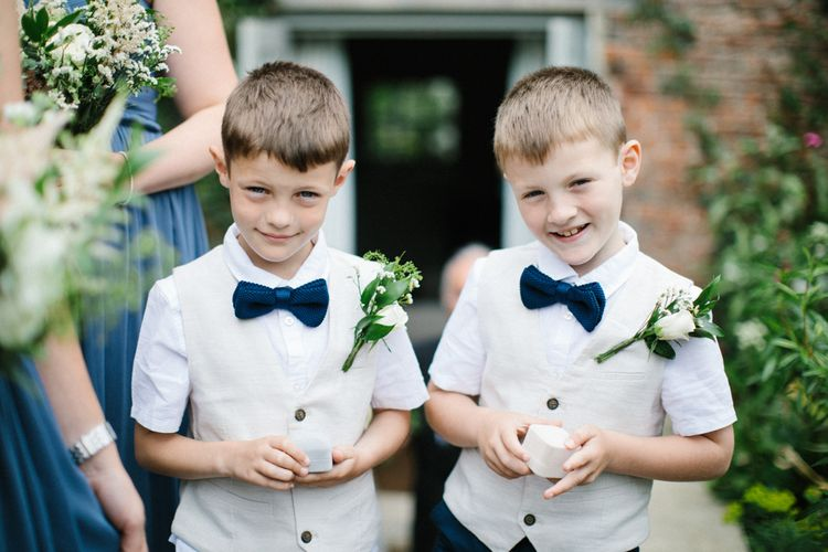 Page Boys in Beige Waistcoats with Black Bow ties