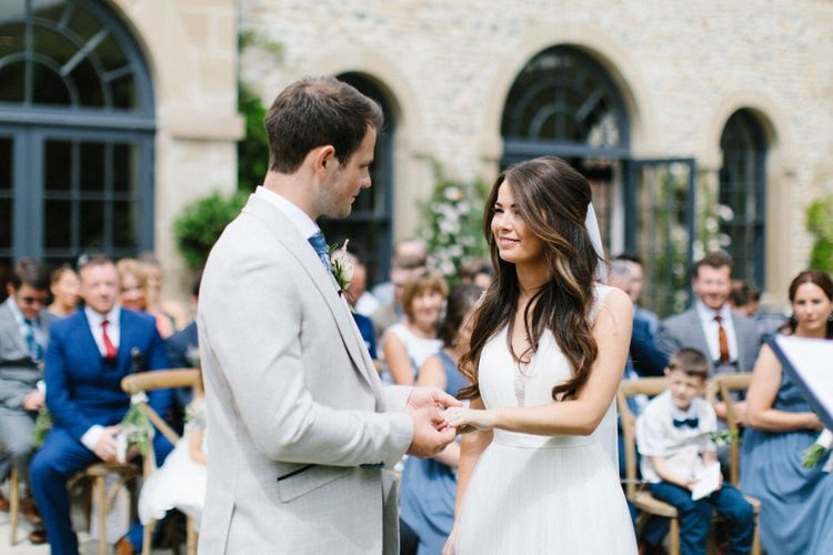 Bride and Groom Exchange Vows at Outdoor Wedding Ceremony at Middleton Lodge