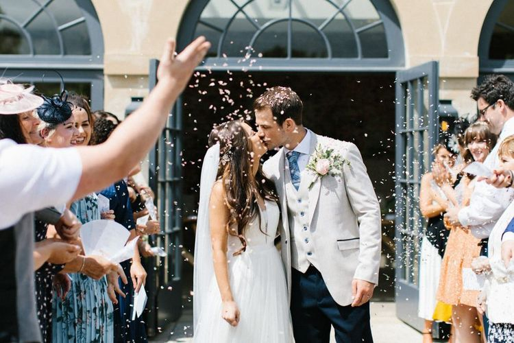 Confetto Moment with Bride in Catherine Deane Wedding Dress and Groom in Beige Blazer