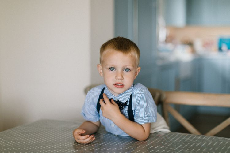 Page Boy in Stripe Shirt, braces and bow tie on wedding morning