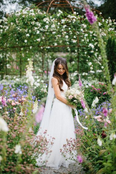 Bride in Catherine Deane Wedding Dress and Tulle Overskirt