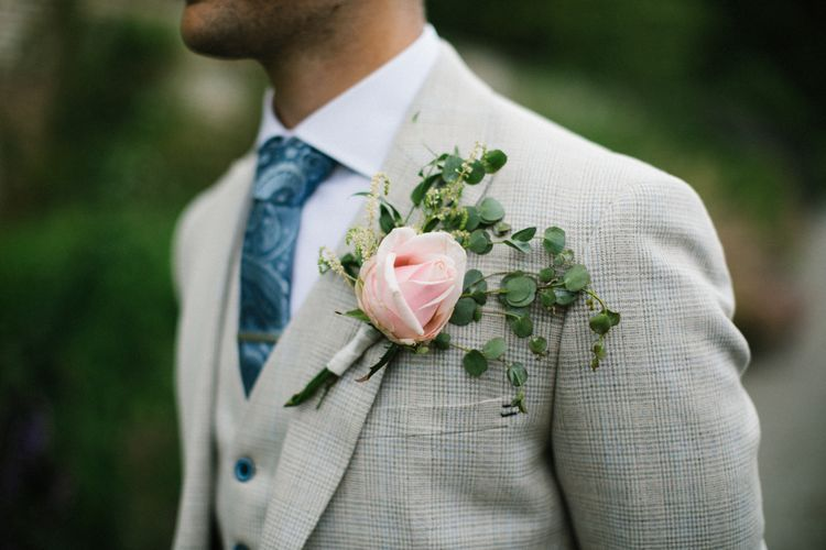 Pink Rose Buttonhole with Foliage