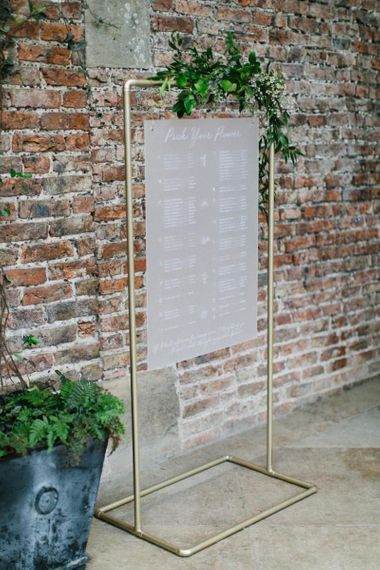 Frosted Acrylic Wedding Signs Seating Chart Hanging on Gold Metal Frame