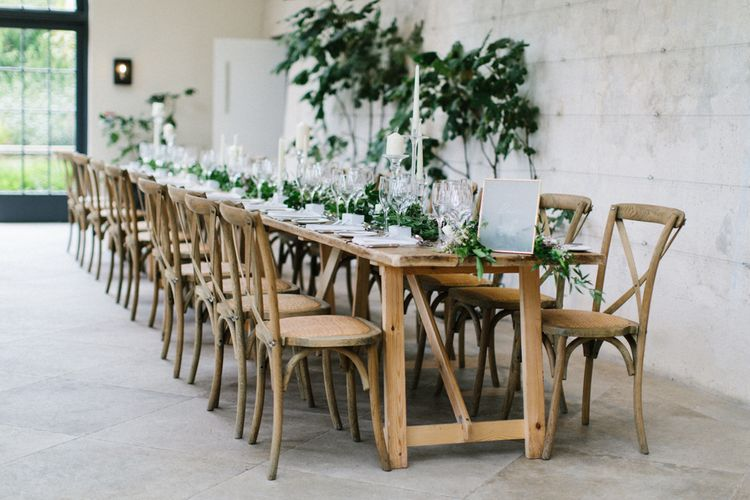 Long wooden wedding breakfast table at The Fig House, Middleton Lodge with Acrylic Wedding Signs