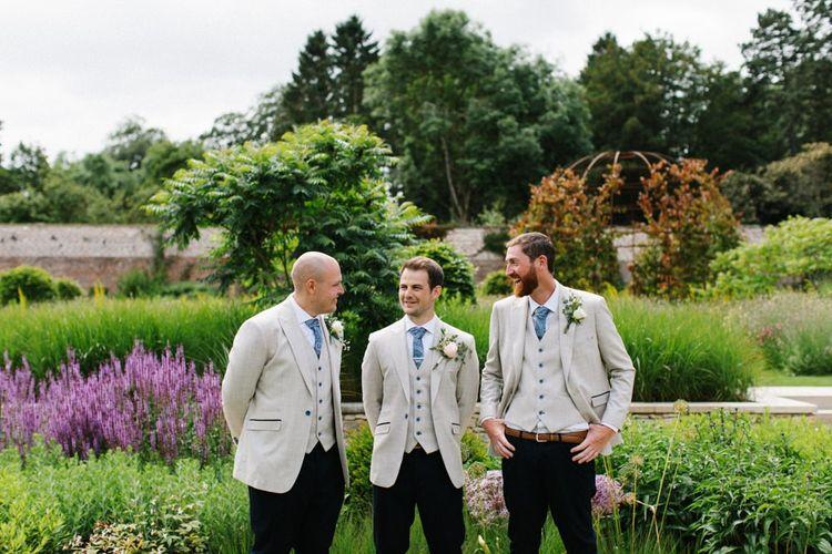 Groomsmen in Black Trousers and Beige Blazers with Blue Ties