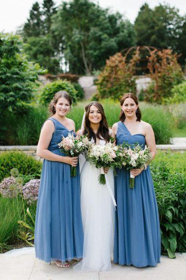 Bridal Party Portrait with Bridesmaids in Once Shoulder Blue Dresses